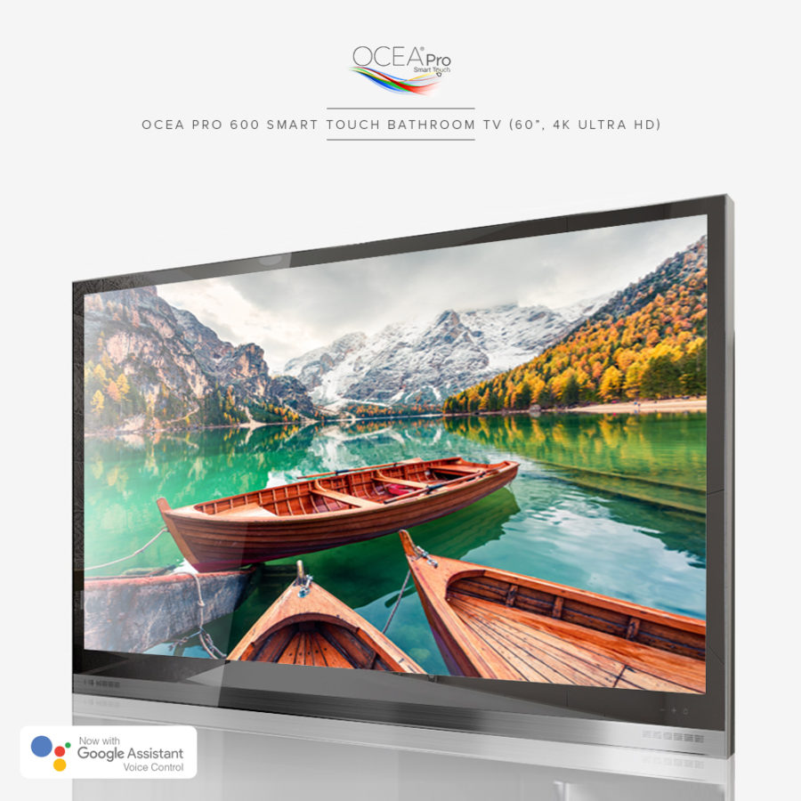 A beautiful scenenery of a lake with rowboats and mountains displayed on a bathroom TV.