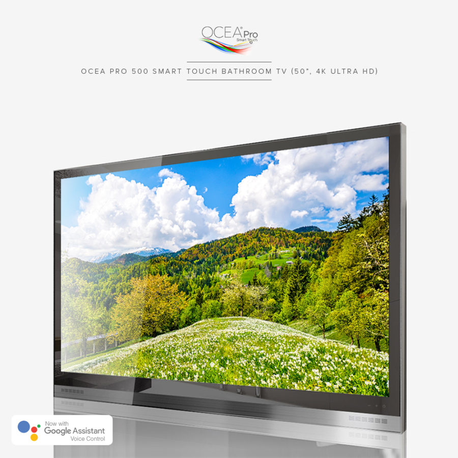 A black bathroom TV displaying a very clear and beautiful scenery of green hills and trees on its screen.