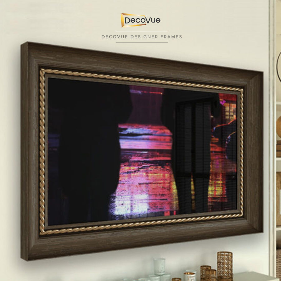 Wooden smart mirror TV frame with gold trimmings that quickly blends in when the TV is turned off.